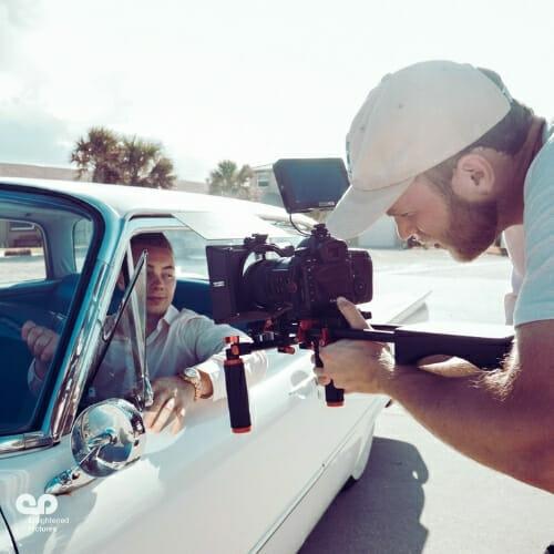man-filming-car-production-LA