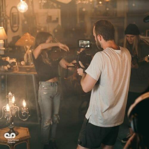 man-taking-video-girl-playing-violin-LA